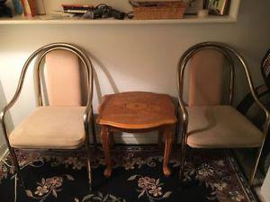 2 golden chairs with wooden coffee table