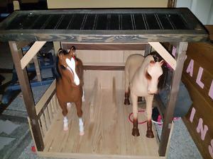 Horse barn with 2 horses.