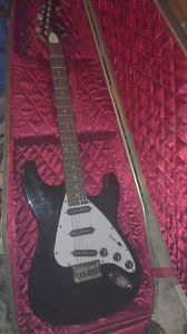 First Act ME  + Casket Guitar Case by Warwick.