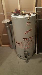 Hot water tank for in floor heating
