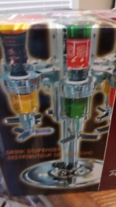 New Liquor Dispenser Still in box never opened Holds four