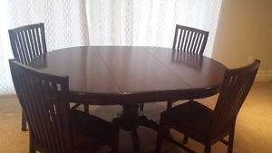 Used dining room table and 4 chairs