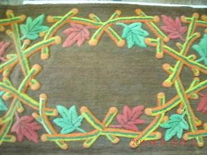 HAND WOVEN, HAND DYED, ALL WOOL RUG. NEVER USED AS A RUG