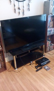 55 inch Sony flat screen with tv stand and ps3