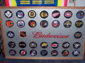 COOL NHL BUDWEISER SIGN WITH ALL THE NHL TEAM PUCKS