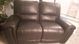 Leather reclining power loveseat. Need gone asap