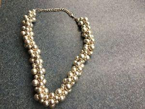 Silver choker style faux pearl necklace