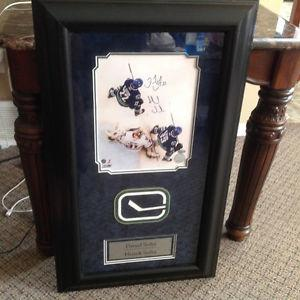 Framed autographed Sedin brothers picture