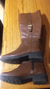 One pair of black and one pair of brown leather boots