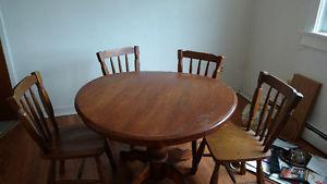 Dark wood round table and chairs