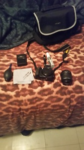 Nikon D with cleaning supplies and lense
