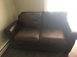Leather couch and love seat $350 obo