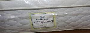 New pocket coil queen mattress in plastic