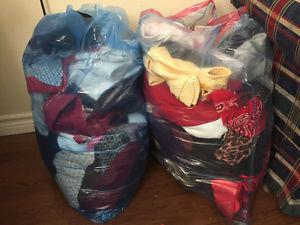 2 blue bags full of women cloth in good condition