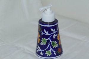 Dark blue soap dispenser