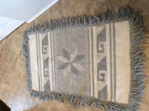Like new hand made accent rug $ firm