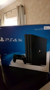 PS4 PRO AND 2 CONTROLLERS
