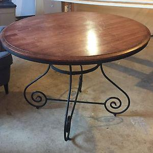 Round wood and rod iron dining table