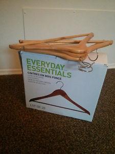 Box full of new wooden hangers