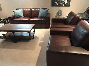 Brand new couch and 2 arm chairs. Top grain leather