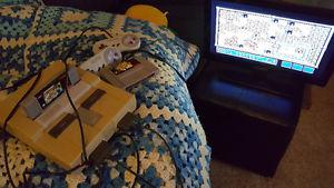 Super Nintendo 2 controllers and mario all stars