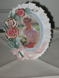 A VERY SPECIAL LACY OVAL STAND-UP MINI PICTURE FRAME...