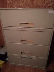 4 Door File Cabinet. Bottom slides out. Good shape