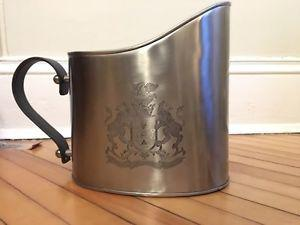 Attractive stainless steel watering can with crest