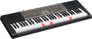Casio light up Glow Keyboard. Keys light up, Red when