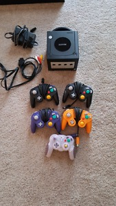 Gamecube with 5 controllers and 2 games.