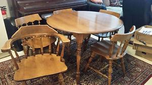 Oak table, with 5 chairs (one captain) and 2 leafs
