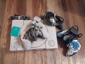 PlayStation 1 with 2 controllers and games