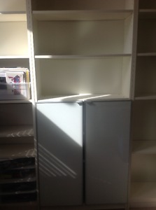 Three IKEA shelving units