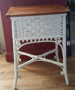 ANTIQUE WICKER TABLE WITH LIFT UP OAK TOP.