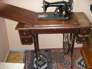 Antique sewing machine with original table