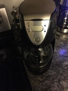 GE black and silver coffee maker