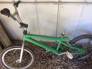 Green and chrome bmx bike, (20 Inch tires)
