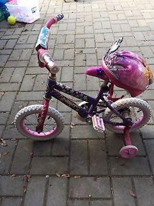 Pink girls bike with helmet
