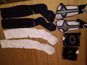 Soccer shin guards and 2 pairs of socks.
