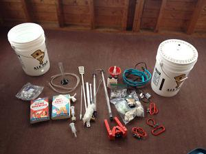 Complete beer making kit with equipment, bottles and 2 books