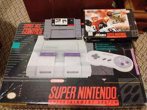 SNES in box, 2 controllers, and 2 games