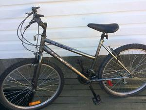 Women's Triumph 18 speed mountain bike, (26 Inch tires)