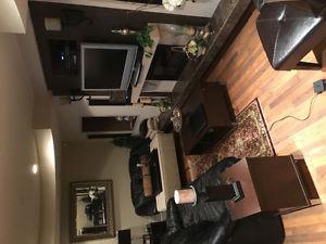 Black leather sofa set and coffee table set