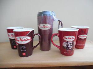 4 Tim Horton Limited Edition Collector mugs and 1 Take Out