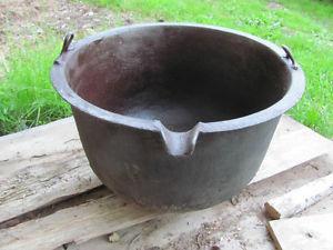 Vintage cast iron cauldron 24 inches in diameter,16 high