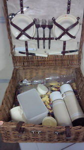 Vintage wicker picnic basket with accessories