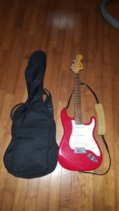 fender sqier strat with leather strap and gig bag $140