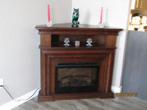 LIKE NEW CORNER FIREPLACE WITH REMOTE