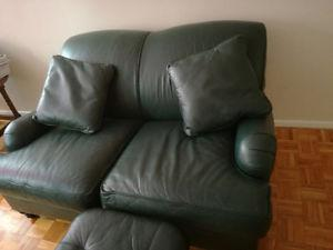 Dark green leather loveseat going cheap