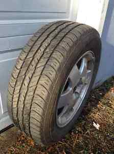 Set of four all weather tires on rims, reduced price.